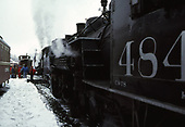 A C&amp;TS double-headed rotary train with #484 as the road engine waiting for departure in the Chama yards.<br /> C&amp;TS  Chama, NM