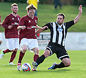 Fraserburgh's Marc Dickson challenges Linlithgow's Roddy Maclennan.