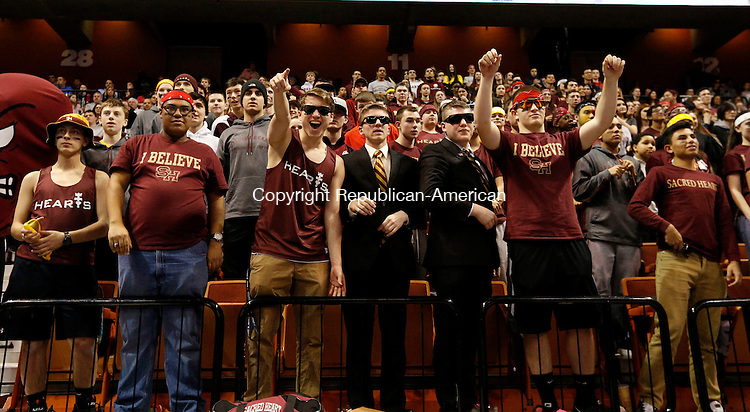 Uncasville, CT- 22 March 2015-032215CM29 Sacred Heart  fans cheer on their team as they play against Valley Regional during the Class S state championship game at Mohegan Sun Arena in Uncasville on Sunday.    Christopher Massa Republican-American