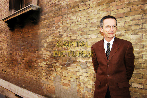 "PATRICE LECONTE.Photocall for ""Mon meilleur ami"" (My Best Friend), Rome, Italy..November 27th, 2006.half length brown suit jacket glasses.CAP/CAV.©Luca Cavallari/Capital Pictures"