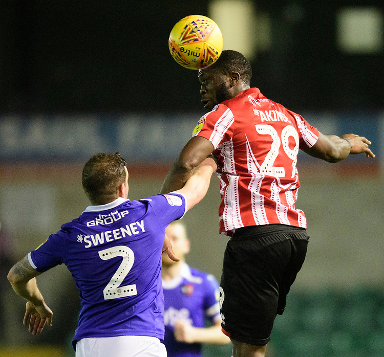 Lincoln City's John Akinde vies for possession with Exeter City's Pierce Sweeney<br /> <br /> Photographer Chris Vaughan/CameraSport<br /> <br /> The EFL Sky Bet League Two - Lincoln City v Exeter City - Tuesday 26th February 2019 - Sincil Bank - Lincoln<br /> <br /> World Copyright © 2019 CameraSport. All rights reserved. 43 Linden Ave. Countesthorpe. Leicester. England. LE8 5PG - Tel: +44 (0) 116 277 4147 - admin@camerasport.com - www.camerasport.com