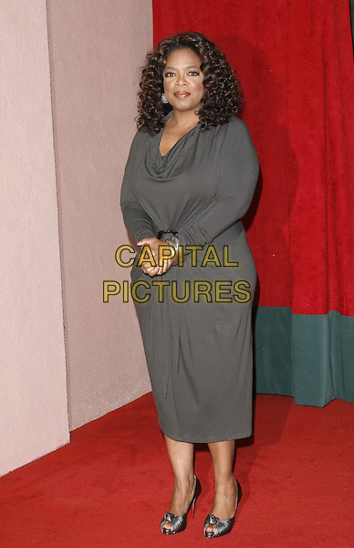 OPRAH WINFREY .at The Hollywood Reporter's Annual Women in Entertainment Breakfast held at The Beverly Hills Hotel in Beverly Hills, California, USA, .December 5th 2008.                                                                     .full length grey gray dress long sleeved Christian Louboutin shoes peep toe shoes .CAP/DVS.©Debbie VanStory/Capital Pictures