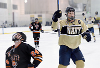 Navy captain Alex Vandenberg (left) and Joe Walton (right) celebrate after a goal, while RIT's Frank Tedeschi (24) reacts differently. Navy defeated RIT 4-2 at McMullen Hockey Arena in Annapolis, MD.