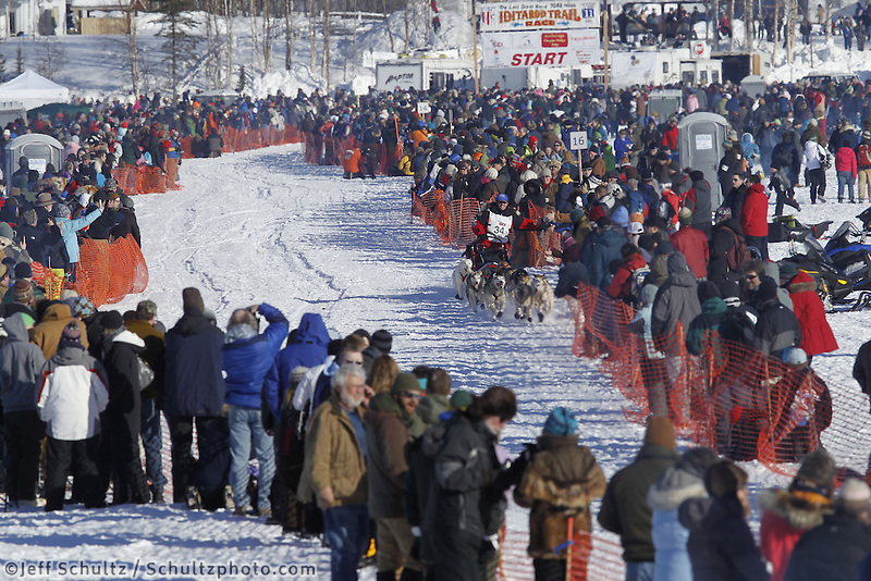 Paul Gebhardt runs down the chute in Willow, Alaska duirng the re-start of the 2011 Iditarod.