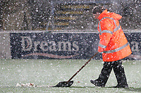 A Wycombe steward clears the snow from the white lines ahead of kick-off during Wycombe Wanderers vs Macclesfield Town, Coca Cola League Division Two Football at Adams Park on 28th October 2008