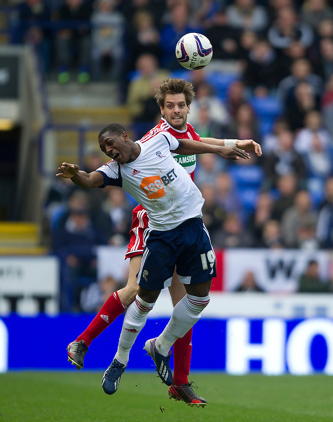 Middlesbrough's Jonathan Woodgate and Bolton Wanderers' Marvin Sordell .. - (Photo by Stephen White/CameraSport) - ..Football - npower Football League Championship - Bolton Wanderers v Middlesbrough - Saturday 20th April 2013 - Reebok Stadium - Bolton..© CameraSport - 43 Linden Ave. Countesthorpe. Leicester. England. LE8 5PG - Tel: +44 (0) 116 277 4147 - admin@camerasport.com - www.camerasport.com