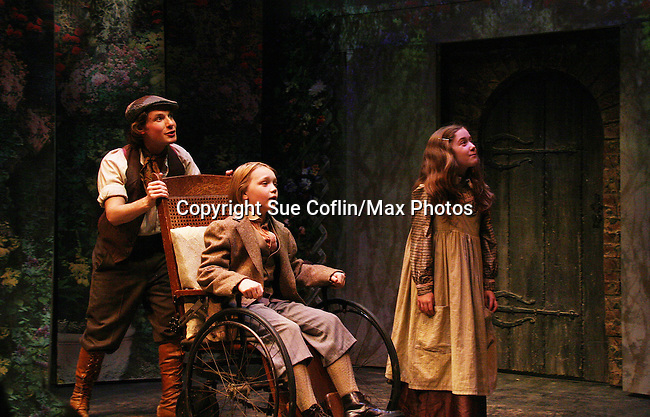 """Zach Fineblum - Charlie Plummer - Isabella Convertino as Philipstown Depot Theatre presents The Secret Garden on November 15, 2009 in Garrison, New York. The musical The Secret Garden is the story of """"Mary Lennox"""", a rich spoiled child who finds herself suddenly an orphan when cholera wipes out the entire Indian village where she was living with her parents. She is sent to live in England with her only surviving relative, an uncle who has lived an unhappy life since the death of his wife 10 years ago. """"Archibald's son Colin"""", has been ignored by his father who sees Colin only as the cause of his wife's death.This is essentially the story of three lost, unhappy souls who, together, learn how to live again while bringing Colin's mother's garden back to life. (Photo by Sue Coflin/Max Photos)...."""