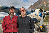 Pilots Dirk and Danielle by their plane in the Gates of the Arctic National Park, Alaska