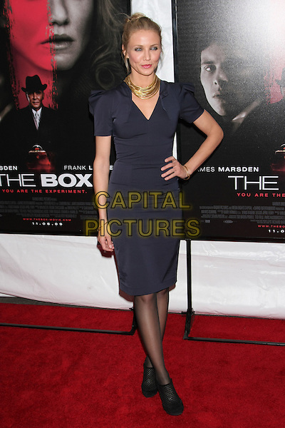 """CAMERON DIAZ .""""The Box"""" New York City Premiere at the AMC Lincoln Square, New York, NY, USA. .November 4th, 2009 .full length black white gold necklaces black blue navy shoulder pads hair up hand on hip ankle boots shoes fishnet.CAP/LNC/TOM.©TOM/LNC/Capital Pictures."""