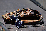 1984:  A detail view of a baseball glove along with sport sunglasses circa 1984.  (Photo by Rich Pilling)