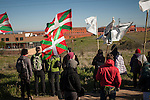 People taking part on the march,  with basque flags and banners asking the repatriation of basque prisoners, shout slogans using a megaphone. Caceres (Spain). February 20, 2016. Some friends and relatives of Basque political prisoners take part on a march to Caceres penitentiary center, within the campaign of 40 marches to 40 prisons where Basque prisoners are imprisoned. These marches are to denounce the dispersal policy those prisoners suffer since more than 25 years. (Gari Garaialde / Bostok Photo)