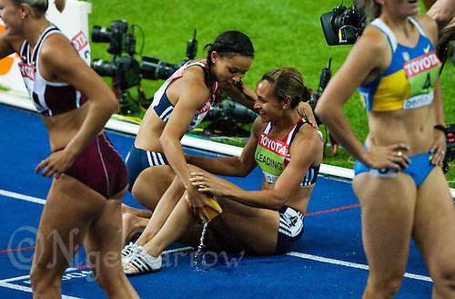 16 AUG 2009 - BERLIN, GER - Jessica Ennis recovers, with the assistance of team mate Louise Hazel, after winning  her 800m heat and  the Heptathlon at the World Athletics Championships .(PHOTO (C) NIGEL FARROW)