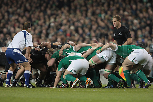 20.11.2010 International Rugby Union from Lansdowne Road Dublin. Ireland v New Zealand. Andy Ellis (New Zealand) prepares the put the ball in to the scrum while Marius Jonker, referee (SARU) looks on.