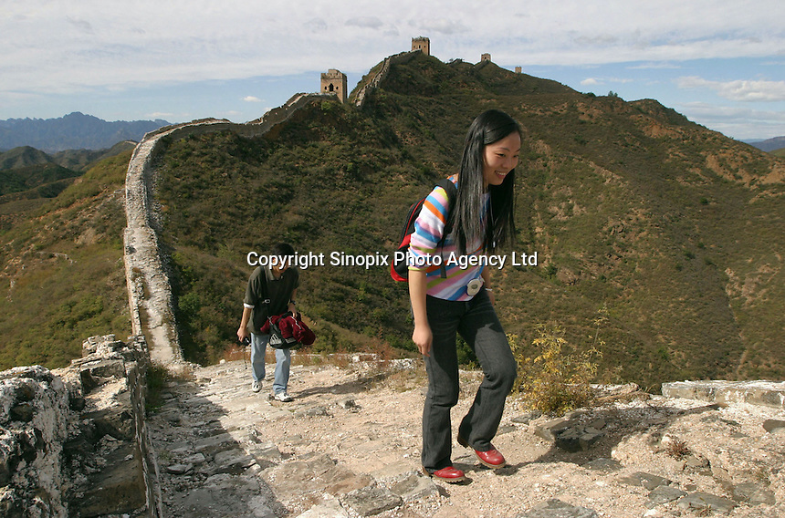 Tourists visit the Great Wall in Beijing, China. The Great Wall is a ruin in many places and hiking has been banned along some parts..20-OCT-03