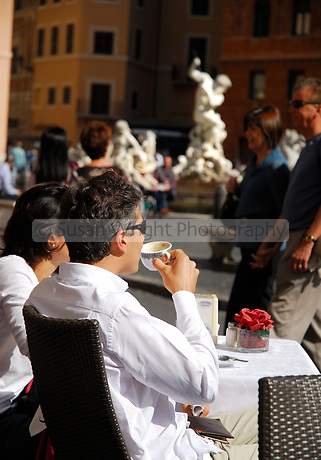 Couple drinking coffee in Piazza Navona, Rome, Italy