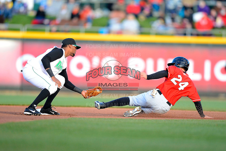 Dayton Dragons second baseman Robert Ramirez #13 attempts to tag Joey Rickard #24 sliding in during a game against the Bowling Green Hot Rods on April 20, 2013 at Fifth Third Field in Dayton, Ohio.  Dayton defeated Bowling Green 6-3.  (Mike Janes/Four Seam Images)