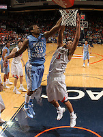 North Carolina forward James Michael McAdoo (43) reaches for the rebound with Virginia forward Anthony Gill (13) during an NCAA basketball game against Virginia Monday Jan. 20, 2014 in Charlottesville, VA. Virginia defeated North Carolina 76-61.