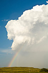 Rainbow after clearing late afternoon thunder and hail storm in the Sand Hills near Merriman, Nebraska