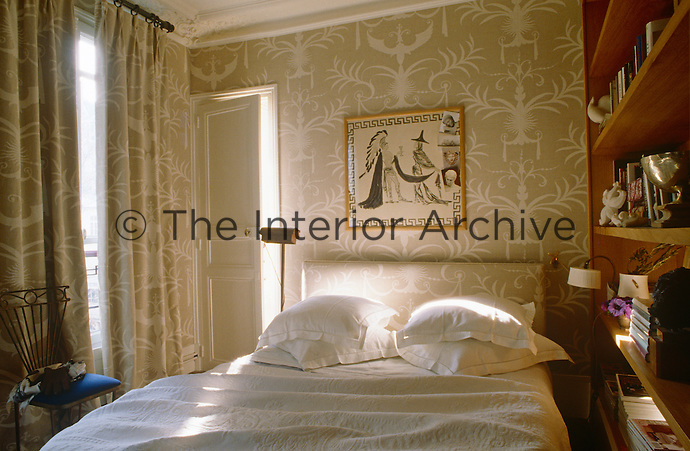 In the bedroom the wallpaper, curtains and headboard are all in the same delicate grey and white print, giving a sense of cohesion as well as maximising the space of the room