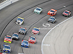 Nascar Sprint Cup Series drivers come around turn four during the Samsung Mobile 500 Sprint Cup race at Texas Motor Speedway in Fort Worth,Texas.