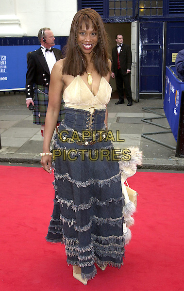 TRISHA GODDARD.BAFTA Television Awards, London, 21st April 2002..full length fashion disaster denim ruffle skirt lace up.Ref:PL.©Capital Pictures.sales@capitalpictures.com.www.capitalpictures.com