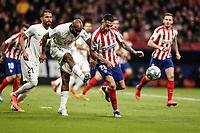 8th February 2020; Wanda Metropolitano Stadium, Madrid, Spain; La Liga Football, Atletico de Madrid versus Granada; Dimitri Foulquier (Granada CF) shoots as he is pressured by Vitolo of Atletico