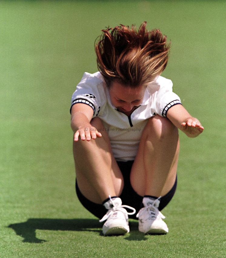 Photo. Richard Lane. .International Ladies Tennis, Eastbourne. 16/6/99..Martina Hingis in playful mood..