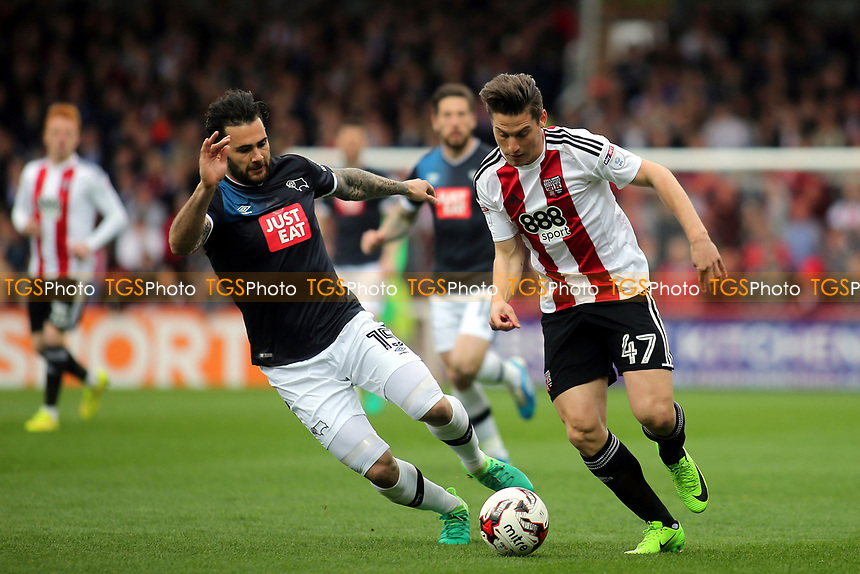 Sergi Canos of Brentford takes on Derby's Bradley Johnson during Brentford vs Derby County, Sky Bet EFL Championship Football at Griffin Park on 14th April 2017