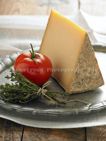 Fontina, a whole tomato, and fresh thyme.