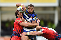 Taulupe Faletau of Bath Rugby is double-tackled. Aviva Premiership match, between Bath Rugby and Worcester Warriors on October 7, 2017 at the Recreation Ground in Bath, England. Photo by: Patrick Khachfe / Onside Images