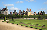 The Grand Parterre, the largest formal garden in Europe, created 1660-64 by Andre Le Notre and Louis Le Vau for King Louis XIV, with the South wing of the Cour des Offices, built 1606-09, Chateau de Fontainebleau, France. The Palace of Fontainebleau is one of the largest French royal palaces and was begun in the early 16th century for Francois I. It was listed as a UNESCO World Heritage Site in 1981. Picture by Manuel Cohen