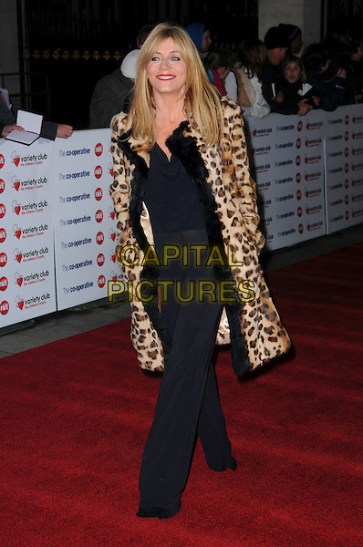 MICHELLE COLLINS .The Co-operative Variety Club Showbiz Awards, Grosvenor House Hotel, Park Lane, London, England, UK, .14th November 2010. .full length black trousers fur leopard print animal coat .CAP/CAS.©Bob Cass/Capital Pictures.