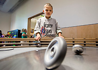 NWA Democrat-Gazette/JASON IVESTER<br /> Izaak (cq) Valdez, Tucker Elementary kindergartener, watches a spinning wheel in one of the exhibits Thursday, March 16, 2017, at the Scott Family Amazeum in Bentonville. About 100 students from the five kindergarten classes at the Rogers school were on a field trip at the museum.