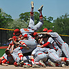 Chaminade High School LF No. 44 Anthony Chiodi leaps atop a pile of celebrating teammates after the Flyers' championship-clinching 10-0 win over St. Dominic in Game 2 of the NSCHSAA varsity baseball final at New York Institute of Technology on Monday, May 25, 2015.<br /> <br /> James Escher