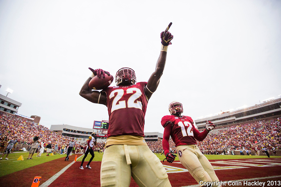 TALLAHASSEE, FLA 9/21/13-FSU-BCC092113CH-Florida State's Telvin Smith celebrates running his interception of a Bethune-Cookman pass for a touchdown as Matthew Thomas, right, joins him in the endzone during first half action Saturday at Doak Campbell Stadium in Tallahassee. <br /> COLIN HACKLEY PHOTO