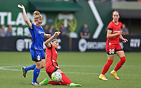 Portland, OR - Sunday, May 29, 2016: Portland Thorns FC forward Nadia Nadim (9) and Seattle Reign FC midfielder Kim Little (8). The Portland Thorns FC and the Seattle Reign FC played to a 0-0 tie during a regular season National Women's Soccer League (NWSL) match at Providence Park.