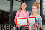 Kate O'Grady from Ballymac and Caoimhe Crowe from Farranfore waiting to open their Leaving Cert results at Brookfield College on Wednesday morning.