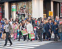 Hordes of shoppers laden with their purchases weave and bob through the crowds of Herald Square in New York on the day after Thanksgiving, Black Friday, November 27, 2015. The National Retail Federation estimates that 135.8 million American will shop in person and online during the four day Thanksgiving weekend.  (© Richard B. Levine)