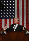 US President Donald J. Trump delivers his first address to a joint session of Congress from the floor of the House of Representatives in Washington, DC, USA, 28 February 2017.  Traditionally the first address to a joint session of Congress by a newly-elected president is not referred to as a State of the Union.<br /> Credit: Jim LoScalzo / Pool via CNP