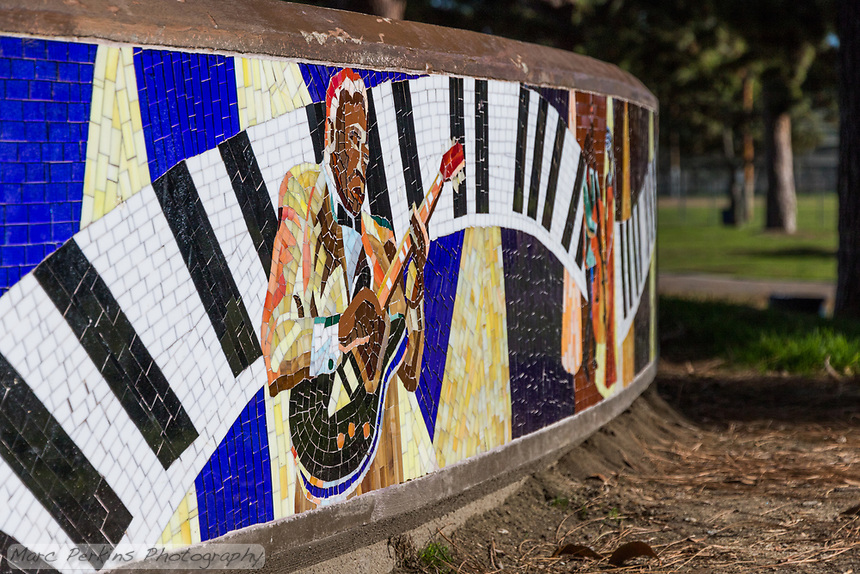 A closeup showing the musician-themed mosaic around the bandstand at South Gate Park.