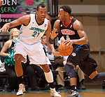 SIOUX FALLS, SD - MARCH 20:  Marqus Blakely #21 from the Sioux Falls Skyforce defends against L.D. Williams #4 from the Springfield Armor in the first half or their game Tuesday night at the Sioux Falls Arena. (Photo by Dave Eggen/Inertia)