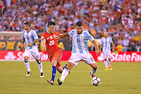 Action photo duringthe match Argentina vs Chile corresponding to the Final of America Cup Centenary 2016, at MetLife Stadium.<br /> <br /> Foto durante al partido Argentina vs Chile cprresponidente a la Final de la Copa America Centenario USA 2016 en el Estadio MetLife , en la foto:(i-d) Sergio Aguero de Argentina y Edson Puch de Chile<br /> <br /> 26/06/2016/MEXSPORT/ISAAC ORTIZ