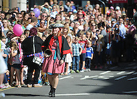 Pictured: Saturday 17 September 2016<br /> Re: Roald Dahl&rsquo;s City of the Unexpected has transformed Cardiff City Centre into a landmark celebration of Wales&rsquo; foremost storyteller, Roald Dahl, in the year which celebrates his centenary.<br /> A town crier gets the crowd going on Westgate Street.