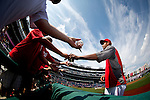 Washington Nationals pitcher Edwin Jackson (33) signs autographs for fans prior to a game against the Miami Marlins at Nationals Park in Washington, DC on September 8, 2012.