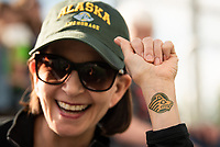 Chancellor Cathy Sandeen shows off her Seawolf pride as she gets ready to throw the first pitch at UAA Night at the Ballpark as UAA hosts a Chugiak-Eagle River Chinooks baseball game at Lee Jordan Field in Chugiak.