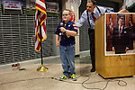 A boy scout prepares to lead the pledge of allegiance at the start of a fundraiser for the Linn County Republican party on Friday, August 5, 2011 in Tiffen, IA.