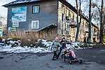 Children play outside a block of apartments on Saturday, October 19, 2013 in Baikalsk, Russia.