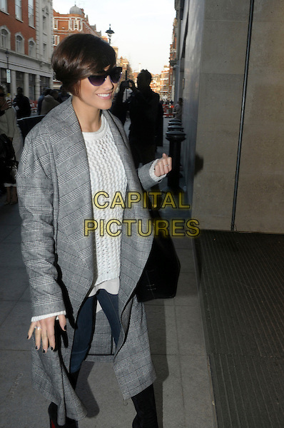 Frankie Sandford.The Saturdays arriving at BBC Radio 1, London, England..4th February 2013.full length sunglasses shades black grey gray coat white top bag purse jacket jeans denim knitted jumper sweater   .CAP/IA.©Ian Allis/Capital Pictures.