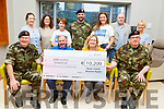 Tracy Costello and members of the Tralee Defences Forces present €10,200 from the Paudie Costello Memorial Skydive fundraiser to the Kerry Hospice at the unit on Friday. <br /> Front l to r: Cpt John Leahy, Joe Hennebery, Tracy Costello and Commandant Brian Rusk.<br /> Back l to r: Noelle McGibney, Margaret Stack, Mary Lou Erwin, Corporal Paul Creighton, Catherine Tagney, John Patton and Andrea O'Connor.