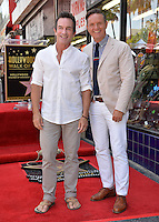 LOS ANGELES, CA. August 11, 2016: Jeff Probst &amp; Mark Burnett at Hollywood Walk of Fame Star ceremony for actress Roma Downey. <br /> Picture: Paul Smith / Featureflash